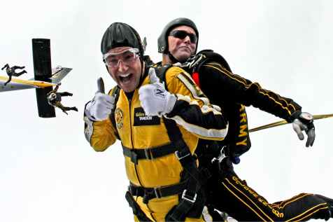 man in yellow jumpsuit and man in black jumpsuit sky diving